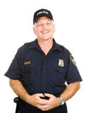 Police Officer Friendly. Friendly, jovial police officer isolated against a white background Royalty Free Stock Image