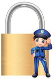 A police officer in front of the giant lock Stock Image