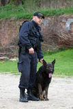 Police officer with a German Shepherd Stock Image