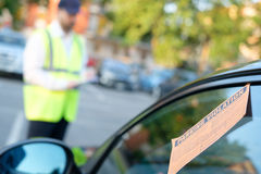 Police officer giving a  fine for parking violation. Police officer giving a ticket fine for parking violation Royalty Free Stock Photography