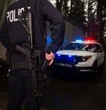 Police Officer grabbing his gun Stock Image