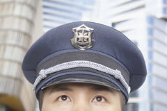 Police Officer, Half Face, Looking Up Royalty Free Stock Image