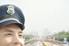 Police officer, half face, portrait Stock Photo