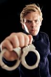 Police Officer with Handcuffs Taking Criminals to Jail Stock Image