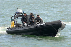Police officer harbour patrol Royalty Free Stock Image