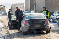 Police officer has stopped driver on road stock photography