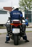 Police Officer with his Motorcycle Royalty Free Stock Photography