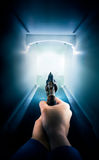 Police officer holding a gun / dramatic lighting. Police in a hallway holding a gun / dramatic lighting Stock Images
