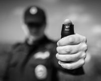 Police officer holding pepper spray. Stock Image