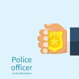 Police officer holds badge in hand. Royalty Free Stock Image