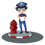 A police officer beside the hydrant Stock Photography