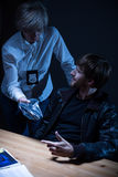 Police officer interrogates a man Stock Images