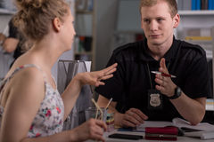 Police officer interrogating woman Royalty Free Stock Photography