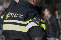 Police officer invigilate in amsterdam Stock Photography
