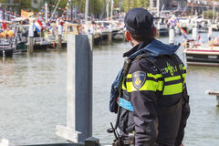 Police officer keeping watch Stock Photos