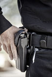 Police officer law enforcement man with gun closeup Stock Photos