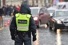 Police officer managing road traffic. Lithuania, Europe Royalty Free Stock Photos
