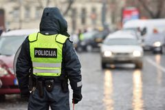 Police officer managing road traffic. Lithuania, Europe Royalty Free Stock Photography