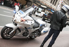 Police Officer with motor bike Stock Photos