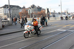 Police officer on a motorcycle accompanying the demo. Zurich, Switzerland - November 26, 2011. A police officer on a motorcycle accompanying the demo Royalty Free Stock Image