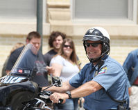 Police Officer in parade in small town America Royalty Free Stock Images