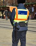 Police officer patrol on the street. Outdoor royalty free stock photography