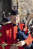 Police officer playing bagpipe at parliament hill Stock Photography