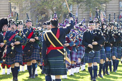 Police officer playing bagpipe at parliament hill royalty free stock photo