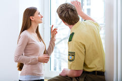Police officer preserving evidence after burglary. In apartment Royalty Free Stock Photo