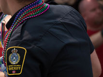 Police officer pride parade background concept gay friendly. Sheriff british columbia sign police department uniform Vancouver Royalty Free Stock Image