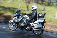 Police officer riding a BWM Police motorcycle. Adelaide, Australia - September 25, 2016: South Australian Police officer riding a BWM Police motorcycle on stock photo