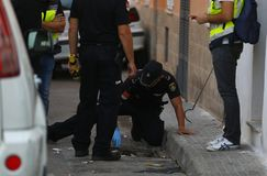 Anti drug raid in mallorca details. A police officer search on the sewers during an anti drug raid in the la soledat square in palma de mallorca city stock photo