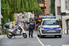 Police officer securing road. STRASBOURG, FRANCE - MAY 19, 2016: Frenc police officer securing roate during a demonstrations against proposed French government`s Stock Image