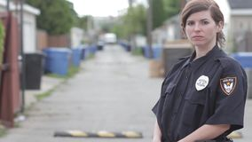 Police officer standing in an alley hd stock video