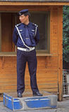 Police officer is standing outdoor. Hangzhou, China - June 29, 2016: police officer is standing outdoor in Hangzhou, China Royalty Free Stock Photo