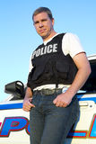 Police Officer Stands Beside His Car Stock Images