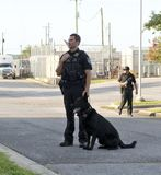 Police Officer stands beside his K-9 Partner. Police K-9 Demonstration at Escambia County Sheriff in Pensacola, Florida Stock Photography