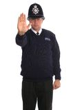 Police Officer - Stop. British Police Officer gesturing for you to STOP Stock Photos