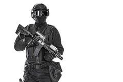 Police officer SWAT. Spec ops police officer SWAT in black uniform and face mask studio shot Stock Photo
