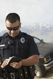 Police Officer Taking Notes Royalty Free Stock Images