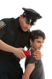 Police officer with teen juvenile delinquent. A policeman with a male juvenile delinquent that has stolen an electronic device. item stock image