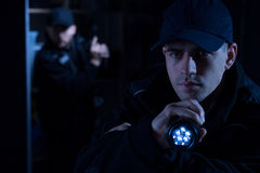 Police officer with torch Stock Photography