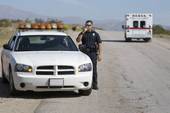 Police Officer Using CB Radio Royalty Free Stock Images