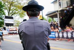 Police officer watching crowd. Crowd control at the Tour de Georgia stock image