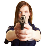 Police officer with weapon. Female police officer aiming with service weapon Stock Photo