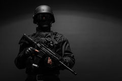 Police officer with weapons Royalty Free Stock Photos