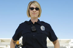 Police Officer Wearing Sunglasses. Female police officer with sunglasses against clear sky Royalty Free Stock Photography
