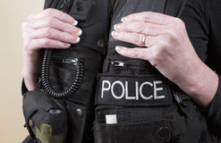 Police officer wearing a tactical vest Royalty Free Stock Photos