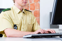 Police Officer working on desk in department Stock Photo