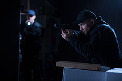 Police officers in action. Image of two police officers in risky action stock image